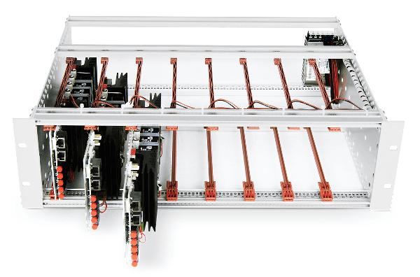 Three full-bridge inverter modules inside an open frame.